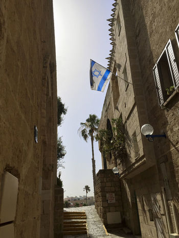 Historic old city of Jaffa, a part of the city of TelAviv in Israel. A Flag of Israel blowing in the wind Cityscape Israel Flag Jaffa Jaffa Israel TelAviv Old Town View Architecture Building Exterior Built Structure City Day Flag Flag Blue White Flag In The Wind Flag Of Israel Historic History Israel Jaffo Jewish Star Low Angle View Outdoors