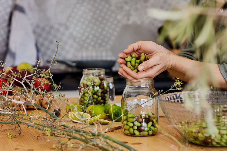 Midsection of person with grapes on table in market