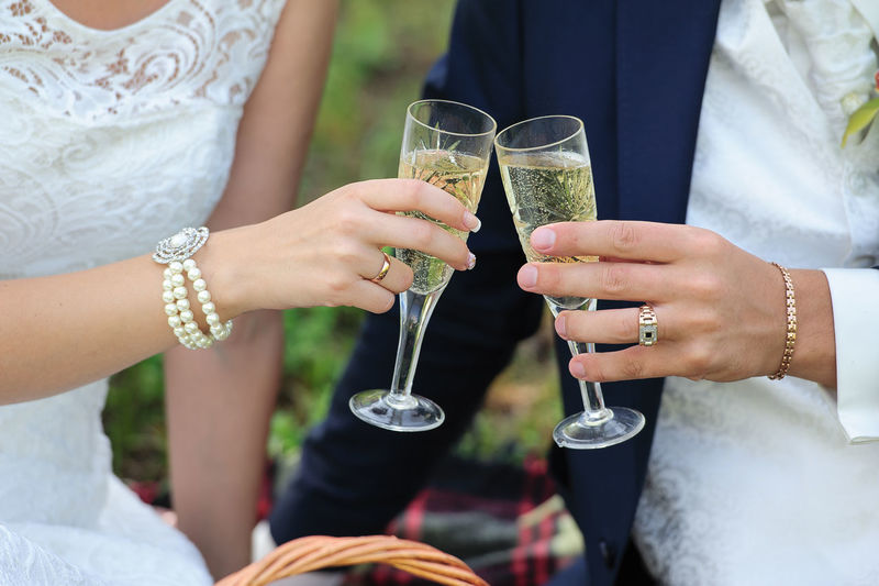 Midsection Of Wedding Couple Toasting Champagne