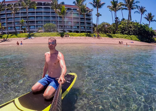 Man on sup standup paddle board off the coast of Maui Hawaii. Taking selfie with resort and beach in background. Action Camera Day Fitness Full Length Gopro Hawaii Health Island Leisure Activity Man Maui Men Muscle Nature Outdoor Recreation Outdoors Paradise People Real People Selfie Standup Paddleboarding Tropical Vacations Water