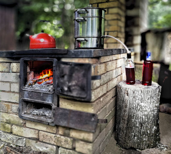 Homemade red currant juice. Steam juicer. Stove. Freshness Homemade Juice Juicer Natural Open-air Rustic Stove Close-up Currant Juice Day Fire Fireplace Food Food And Drink Fresh Healthy Healthy Eating Kitchen No People Old Outdoors Red Rural Scene Steam Juicer