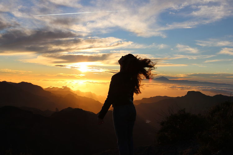 Hair Silhouette Sunset Silhouettes Sunset_collection Beauty Beauty In Nature Clouds Horizon Jumping Leisure Leisure Activity Mountain One Person One Woman Only Sky Sunset Traquility Wind My Best Travel Photo A New Beginning This Is Strength 50 Ways Of Seeing: Gratitude Human Connection Capture Tomorrow Moments Of Happiness 2018 In One Photograph Skate Photography: Same Tricks, New Perspectives Analogue Sound Exploring Fun The Traveler - 2019 EyeEm Awards
