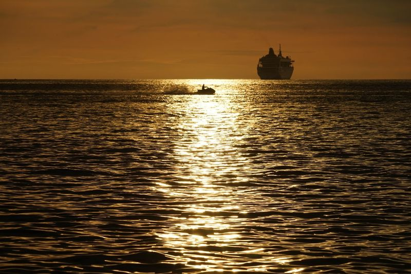 Sunset Sea Nautical Vessel Silhouette Reflection Dusk Fishing Sun Fishing Industry Vacations Horizon Over Water Dramatic Sky Ship Tourism Tropical Climate Sunlight Business Finance And Industry Beach Water Floating On Water Phuket,Thailand Vacations Outdoors Jet Ski
