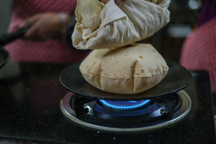 Traditional indian roti bread backed on gas stove