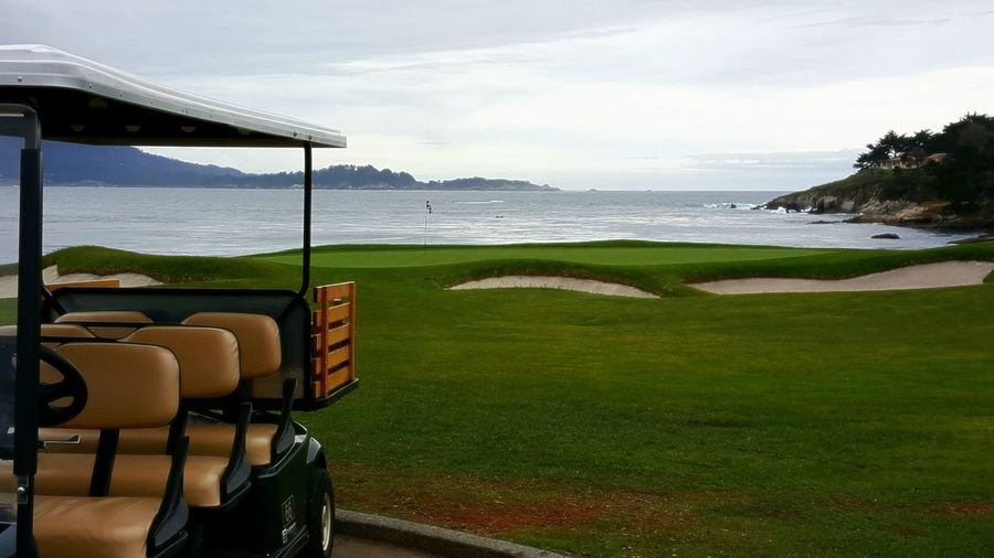 Scenic View Golf Course By Sea Against Sky