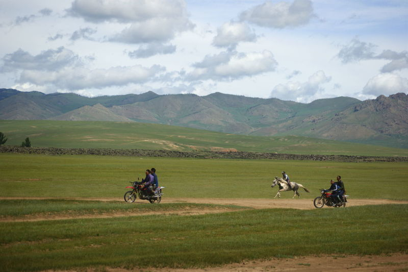 Mongolia Activity Beauty In Nature Cloud - Sky Day Environment Field Grass Horse Racing Land Landscape Mountain Outdoors People Real People Ride Riding Scenics - Nature Sky Steppe Монгол улс