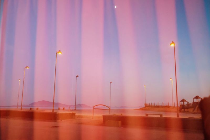 Digital composite image of illuminated street light at night