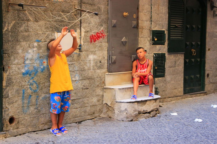 Child Childhood Two People Friendship People Togetherness Young Adult Scène De Rue Innocence Scène De Vie Tourisme Naples Is Wonderful Naples Enfance ! ❤ Italy Outdoors Italie Street Way Of Life Napoli ❤ Naples, Italy City Enfant Jeux D'enfants Life Your Ticket To Europe The Week On EyeEm EyeEmNewHere Paint The Town Yellow