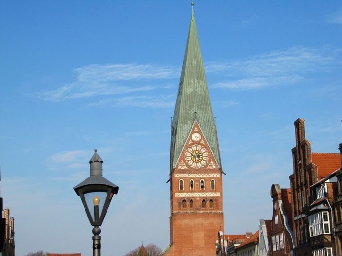 Low angle view of st john church in luneburg against sky