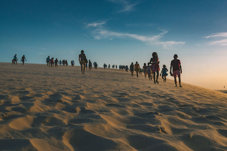 The famous dune in Jericoacoara. Adult Arid Climate Beach Beauty In Nature Day Desert Large Group Of People Leisure Activity Lifestyles Men Nature Outdoors People Real People Sand Sky Sky And Clouds Skyporn Sun Sunrise Sunset Travel Travel Destinations Vacations Women The Street Photographer - 2017 EyeEm Awards The Photojournalist - 2017 EyeEm Awards EyeEmNewHere Sommergefühle EyeEm Selects Connected By Travel This Is Latin America