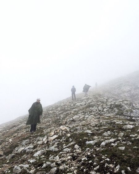 People on mountain during foggy weather