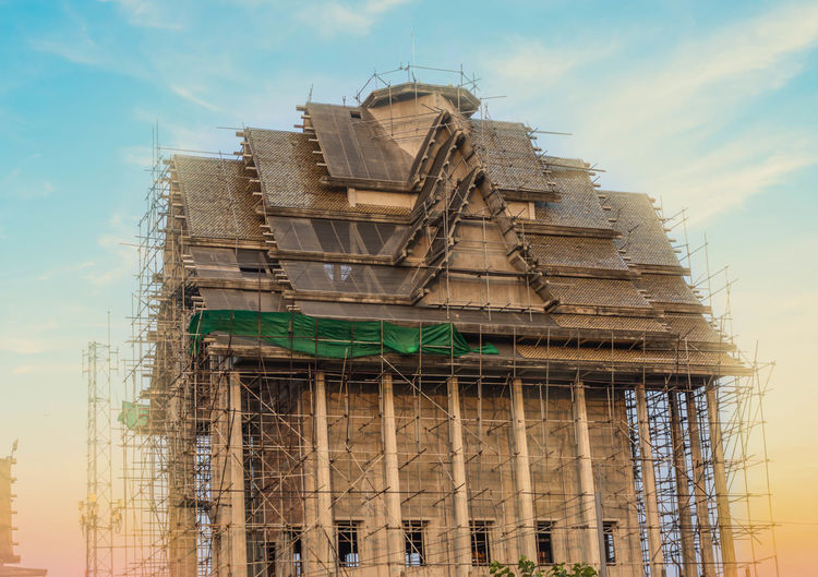 The temple under reconstruction. Chruch Thailand Under Reconstruction Architecture Building Exterior Built Structure Cloud - Sky Day Low Angle View No People Outdoors Religion Sky