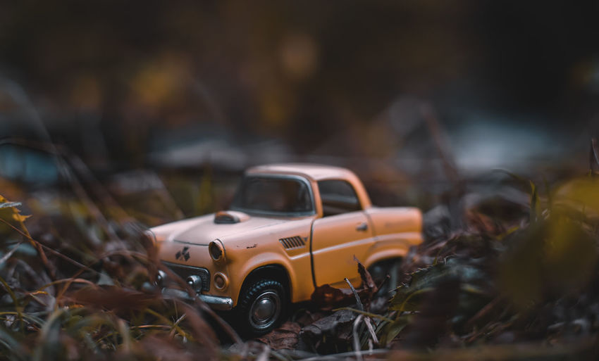 EyeEm Japan ASIA Shootermag AMPt_community Thedarksquare Car Motor Vehicle Mode Of Transportation Transportation Selective Focus Land Vehicle Day No People Toy Abandoned Field Obsolete Nature Outdoors Damaged Toy Car Focus On Foreground Land Old Run-down Deterioration