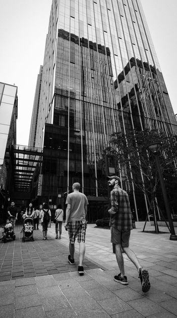 Traveler City Architecture Building Exterior Built Structure Real People City Life Skyscraper Modern Large Group Of People Men Day Outdoors Women Full Length Sky Crowd Adult People Blackandwhite Blackandwhite Photography