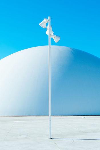 Street light against white dome