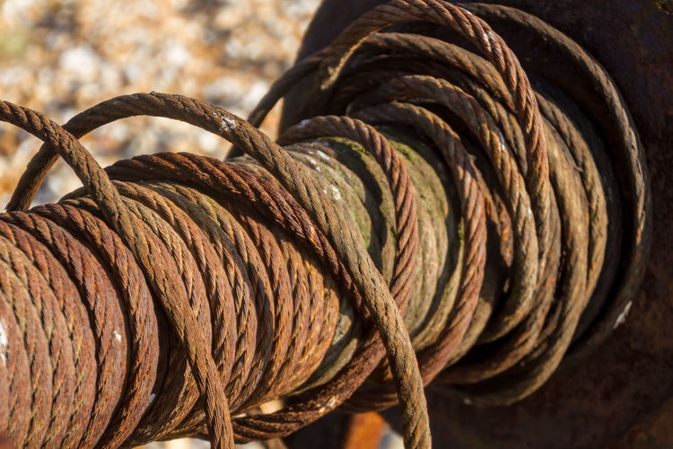 A reel of rope Brown Bundle Close-up Coiled Coiled Rope Fishing Full Frame Intricacy Outdoors Reel Rope Selective Focus Twisted