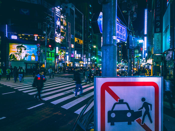 Nightlife Night Lights Japan Tokyo Tokyo Street Photography Neon Urban Urban Life Atmospheric Mood Walking Around Japan Travel Japanese Culture Roppongi Zebra Crossing Crossing The Street Illuminated Sign City Night Building Exterior Architecture Built Structure City Life Communication Road Street Walking Crosswalk Symbol Group Of People Crossing Road Marking Transportation Text City Street Outdoors Guidance Cityscape Light