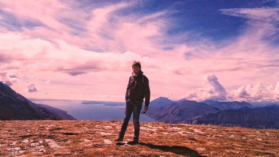 Full length portrait of man standing on mountain against sky