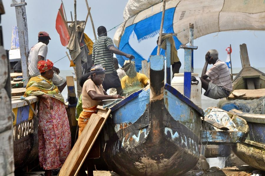 Waiting for the fisher boats coming back Ghana Waiting WestAfrica Africa Beach Developing Country Fisherman Fishing Area Flags Group Group Of People Incidental People Medium Group Of People Nature Nautical Vessel Occupation Pirogue Poverty Real People Social Issue Social Issues Standing Water Working