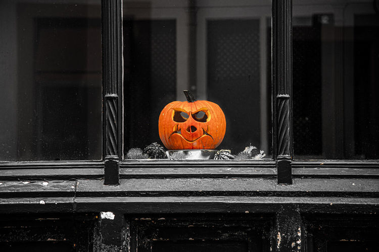 View of pumpkin on window during halloween