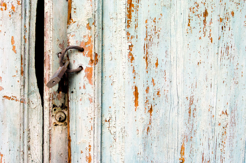 Close-Up Of Rusty Padlock Hanging On Door