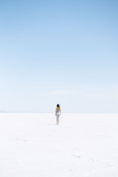 Walking into the void Salt Flats Hat Single Lady Walking Away Walking Alone Woman Sky Land Day Nature Clear Sky Full Length Scenics - Nature Copy Space Beauty In Nature Mineral Environment Salt Flat Horizon Landscape Desert Tranquility Walking