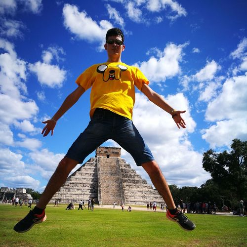 Low Angle View Of Man Jumping On Field At El Castillo Chichen Itza