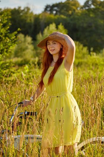 Woman wearing hat on field
