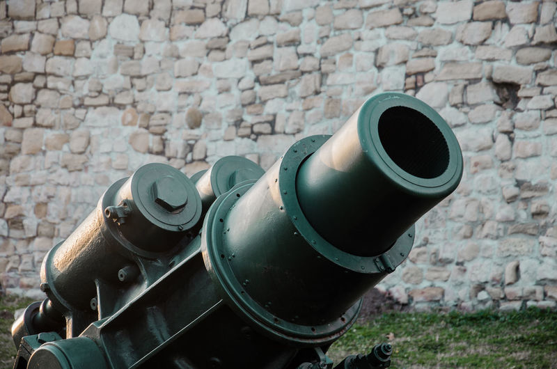 Close-up of cannon against wall