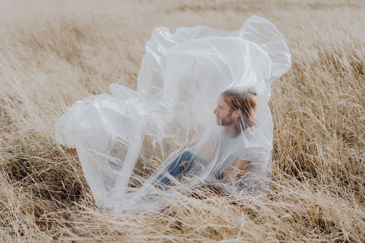 Adult Bride Celebration Event Fashion Field Grass Hairstyle Land Leisure Activity Life Events Nature Newlywed One Person Outdoors Plant Veil Wedding Wedding Dress Women Young Adult