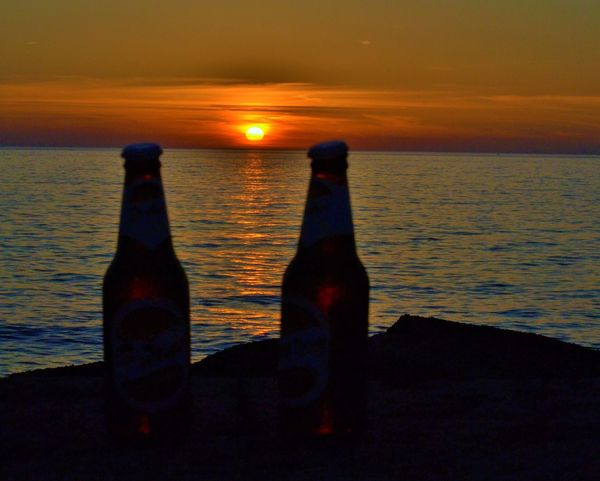 Beauty In Nature Birra Time Cloud Cloud - Sky Drinking Beer Duet Horizon Over Water Idyllic Lifestyles Nature Non-urban Scene Ocean Orange Color Outdoors Remote Rippled Scenics Sea Sea And Sky Sky Sun Sunset Tranquil Scene Tranquility Water