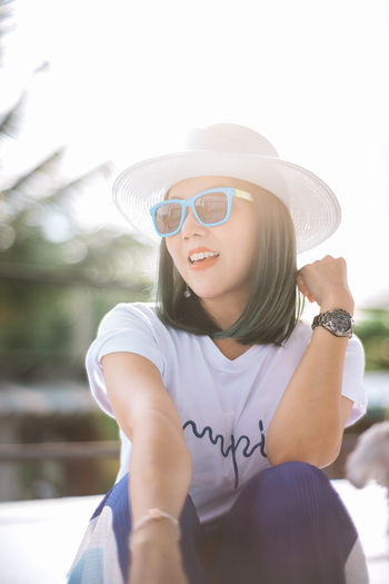 Beautiful Woman Casual Clothing Clothing Day Fashion Fashion Photography Fashion&love&beauty Fashionable Front View Glasses Hairstyle Hat Leisure Activity Lifestyles One Person Outdoors Real People Sitting Smiling SonyA7s Sunglasses Sunlight Three Quarter Length Women Young Adult