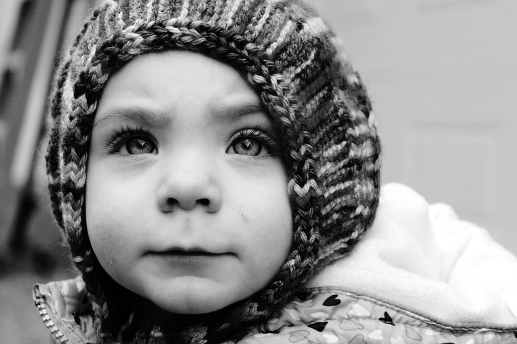Close-up portrait of cute baby girl during winter