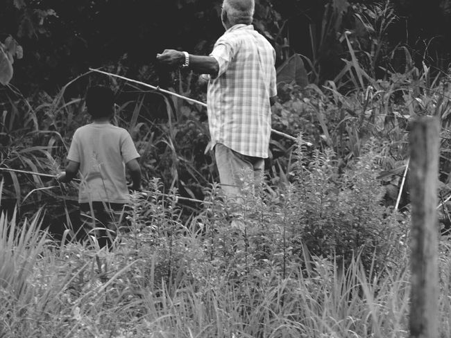 Suriname @south-america Surinamese Suriname❤ People Together People Nature Outdoors Suriname Enjoyment Tranquility Beauty In Nature Summer Landscape Fishinglife Black & White Grandfather Grandson Casual Clothing Fresh On Eyeem  Love Welcomeweekly Monochrome Photography Monochrome Photograhy Family❤ People And Places.