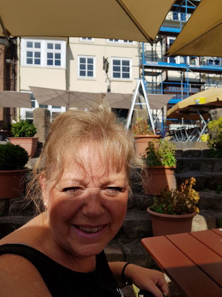 Lueneburg, Lower Saxony, Germany - JULY 28, 2017: Woman sitting in the beer garden of a restaurant in Lüneburg and laughing in the camera Portrait Looking At Camera Headshot Building Exterior Smiling Architecture Real People Lifestyles Senior Adult Women Leisure Activity One Person Adult Built Structure Senior Women Front View Females Happiness Hairstyle