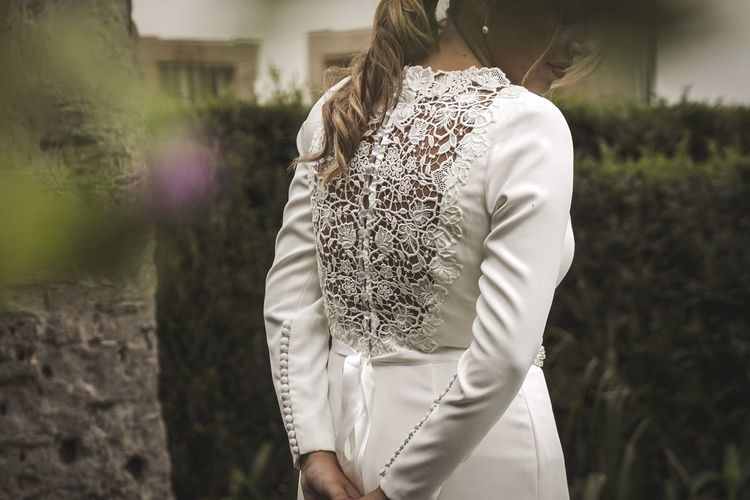 Midsection of bride standing in park