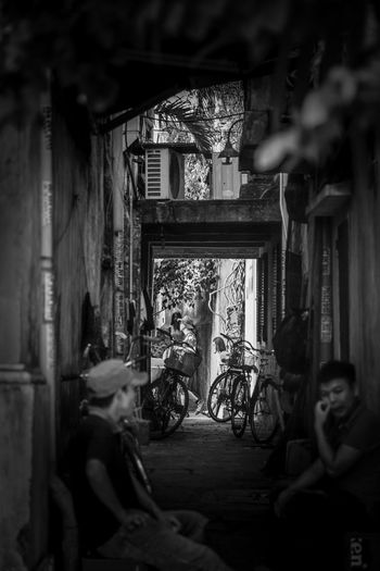 Bnw_friday_eyeemchallenge Blackandwhite Black & White Blackandwhite Photography Vietnam Hoi An Historical Building Built Structure Architecture Day Window Building Architecture People Focus On Background Real People Selective Focus Old