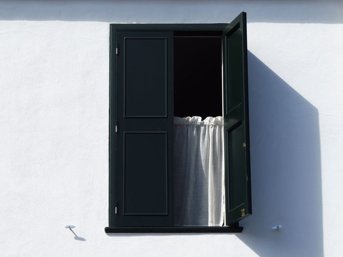 Mediterranean  Mediterranean Architecture Shutters Architecture Balearic Islands Building Building Exterior Curtain Curtains Drapery Drapes  Entrance House Menorca Residential District Shadow Shutter Wall - Building Feature White Color White Wall Window Window Frame Window Shutter Window Sill Windows