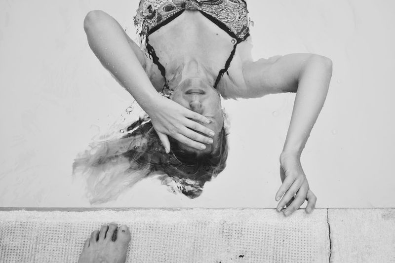 Portrait Foot Floating On Water Blackandwhite Swimming Pool One Person Lifestyles Real People Front View Relaxation Young Adult Women Leisure Activity Lying Down High Angle View Human Arm
