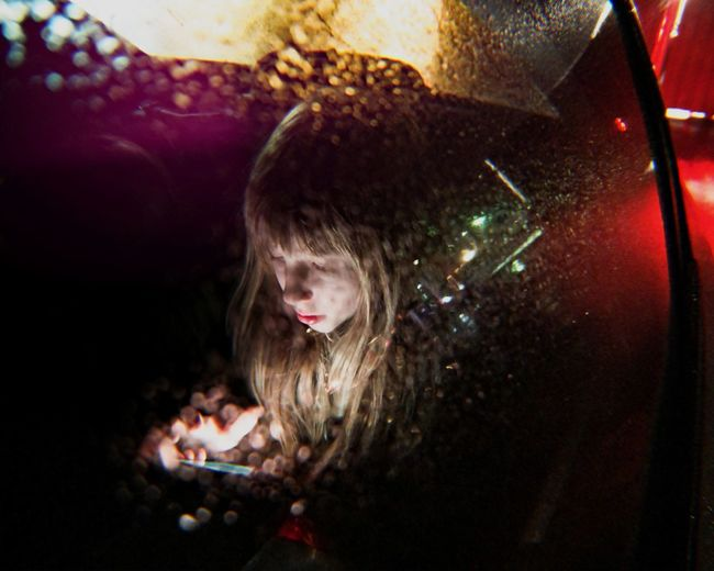 Night Rain Through The Window Colourful Portrait Portrait Of A Woman Neon Childhood Child Portrait Photography Wireless Technology Technology Illuminated Black Background Blond Hair Portable Information Device Communication Mobile Phone Close-up Interactivity Text Messaging Cellphone Smart Phone Social Networking Streetwise Photography