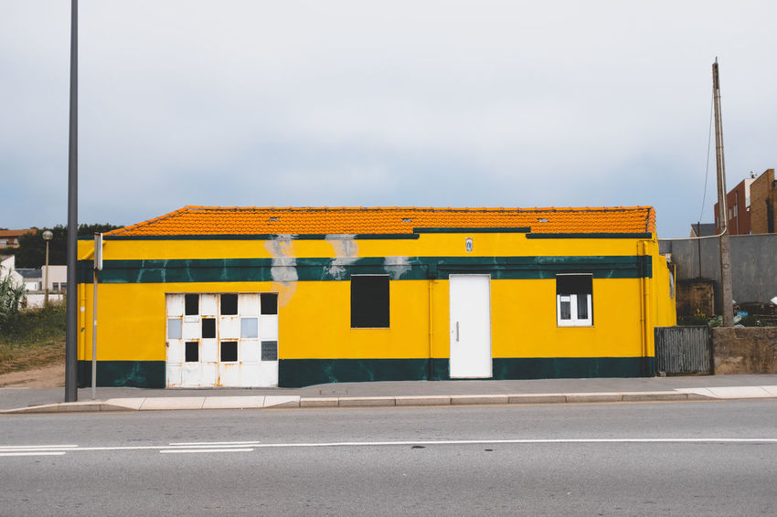 Threeweeksgalicia Built Structure Architecture Yellow Building Exterior City Street Transportation Road No People Day Nature Sky Building Sign Symbol Outdoors Empty Copy Space Road Marking Communication