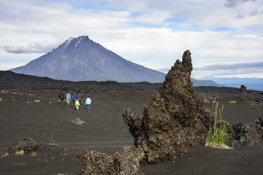 Waves of the clinker (frozen lava) Adult Adventure Beauty In Nature Cloud - Sky Day Far East Kamchatka Landscape Mountain Natural Disaster Nature Outdoors People Russia Sky Small Group Of People Snow Travel Destinations Volcanic Landscape