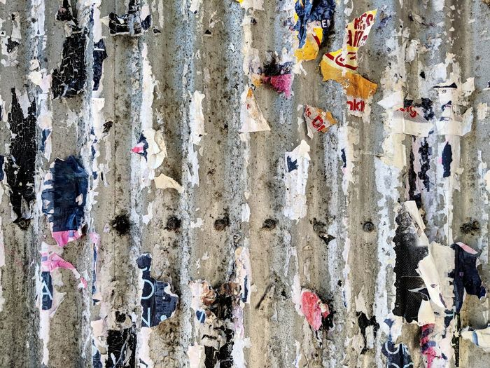 Billboard Backgrounds Full Frame Textured  Multi Colored Paint Pattern Wall - Building Feature Close-up Architecture Built Structure Peeling Off Bad Condition Damaged Weathered