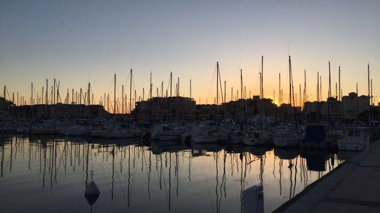 Reflection Sunset No People Built Structure Architecture Water Clear Sky Outdoors Nature Building Exterior Harbor Travel Destinations Sky Mast Nautical Vessel Moored Beauty In Nature Sea Cityscape City