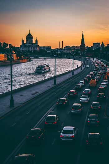 High Angle View Of Traffic On Road In City During Sunset