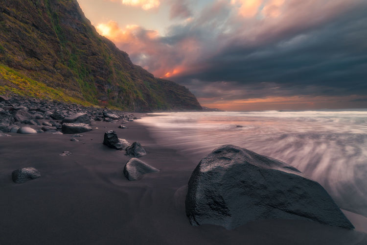 Beach Water Sunset Cloud - Sky Hello World Paradise Movement Landscape Seascape Sky Beauty In Nature Scenics - Nature Sea Nature Tranquility Tranquil Scene Land No People Rock Idyllic Solid Rock - Object Non-urban Scene Horizon Over Water
