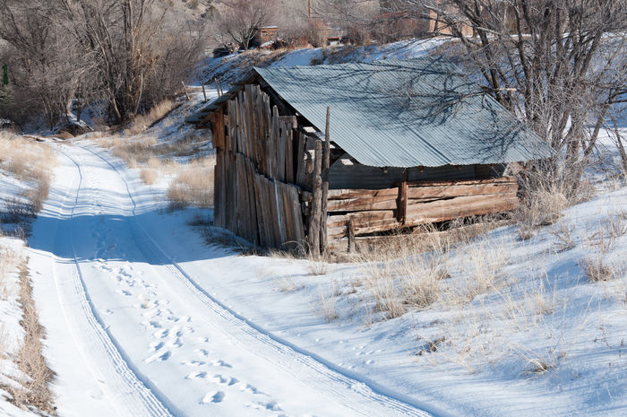A nice scene in Dixon, NM. Beauty In Nature Built Structure Cold Temperature Country Road Countryside Day Footprints New Mexico No People Outdoors Shed Snow Tin Roof Winter Wood - Material The Great Outdoors - 2017 EyeEm Awards Neighborhood Map