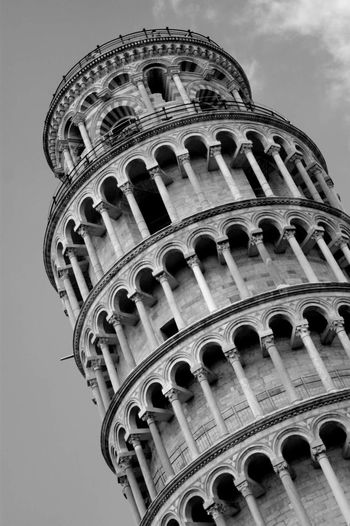 Architecture Building Exterior Built Structure Low Angle View Travel Destinations Arch Travel History Outdoors No People Sky Day City Pisa Leaningtowerofpisa Leaning Tower Of Pisa Italia Italy Tourism Tourist Destination Monochrome Black And White