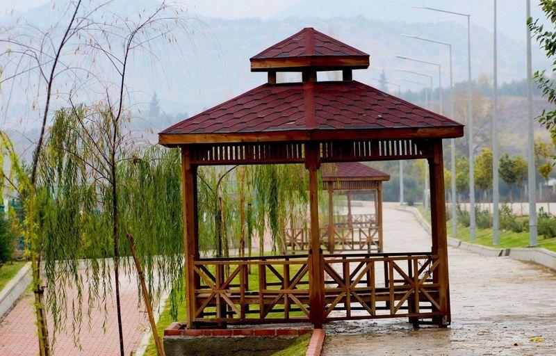 Gazebo by lake against building