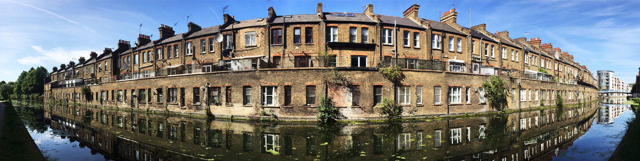 terraced houses looking over a canal Architecture Blue Building Building Exterior Built Structure Canal City Cloud Cloud - Sky Day Housing Housing Crisis In A Row Low Angle View No People Outdoors Reflection Residential Building Residential Structure Sky Sunlight Terraced Houses Terraces Water Window